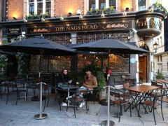 People drinking outdoors at The Nags Head pub in Covent Garden, London (Yui Mok/PA)