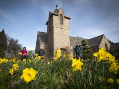 Members of the congregation in the grounds of the Church of Scotland Fairmilehead Parish Church (Jane Barlow/PA)