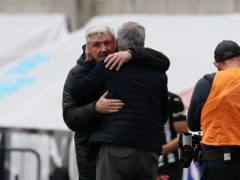 Newcastle head coach Steve Bruce and Tottenham manager Jose Mourinho embrace after the 2-2 draw at St James' Park (Scott Hepell/PA)