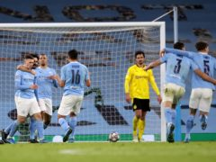 Phil Foden, left, celebrates after giving Manchester City a 2-1 first-leg lead (Nick Potts/PA)