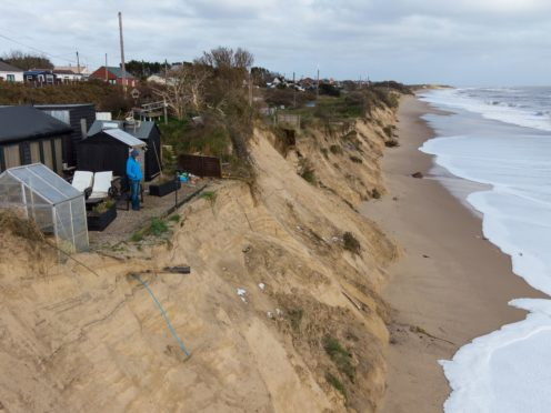 Former soldier Lance Martin's garden in Hemsby, Norfolk, is disappearing due to coastal erosion (Joe Giddens/PA)