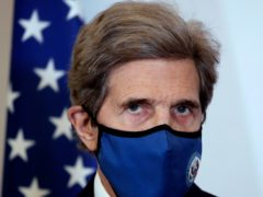 US climate envoy John Kerry is heading to China for talks between the world's two biggest carbon emitters ahead of President Joe Biden's climate summit of world leaders (Christophe Ena/AP)
