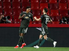 Marcus Rashford, left, celebrates the opener (Fermin Rodriguez/AP)