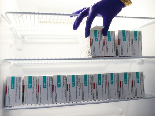 Vials of the Oxford/AstraZeneca vaccine stored in a temperature-controlled fridge (PA)