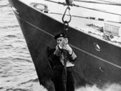 The Duke of Edinburgh transferring ships in 1955 (PA)