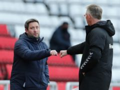 Lee Johnson (left) and Nigel Adkins had contrasting afternoons (Richard Sellers/PA)