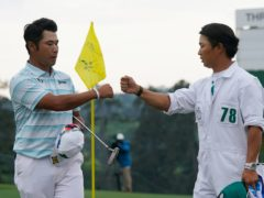 Hideki Matsuyama (left) is congratulated by his caddie Shota Hayafuji after a third-round 65 in the Masters (David J. Phillip/AP)