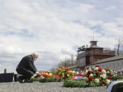 German President Frank-Walter Steinmeier lays a wreath during events marking the 76th anniversary of the liberation of the Buchenwald Nazi concentration camp near Weimar (Markus Schreiber/AP)