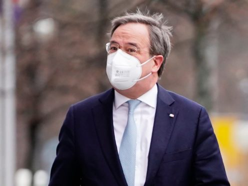 Armin Laschet, CDU federal chairman and minister president of North Rhine-Westphalia, arrives at the CDU presidium meeting in front of party headquarters in Berlin, Germany (Michael Kappeler/dpa via AP)