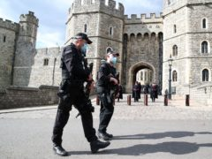 Police outside Windsor Castle, Berkshire (Steve Parsons/PA)