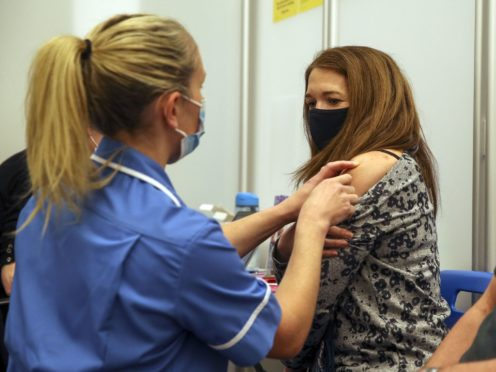 Caroline Nicolls receive an injection of the Moderna Covid-19 vaccine administered by nurse Amy Nash, at the Madejski Stadium in Reading, Berkshire (PA)
