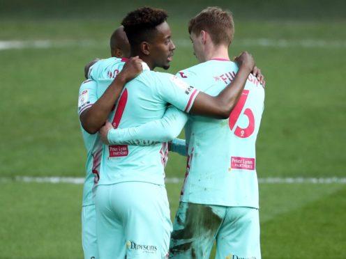 Jamal Lowe celebrates scoring Swansea's opener (Tim Goode/PA)
