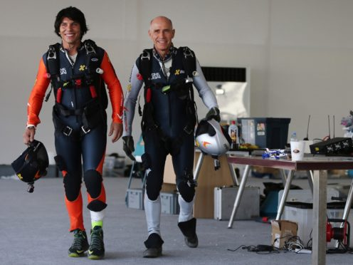 Vincent Reffet, left, was the protege of Swiss pilot Yves Rossy (AP)