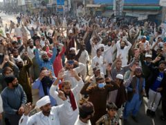 Supporters of Tehreek-e-Labiak Pakistan, a radical Islamist political party, chant slogans during a protest against the arrest of their party leader, Saad Rizvi, in Lahore, Pakistan (K.M. Chaudary/AP)