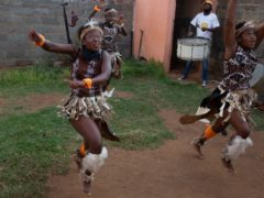 A group of girls perform a traditional Zulu dance (Denis Farrell/PA)