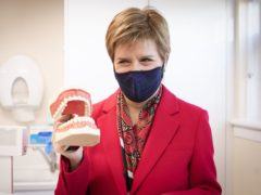 First Minister Nicola Sturgeon has vowed that the SNP will abolish all NHS dentistry charges in Scotland (Jane Barlow/PA)