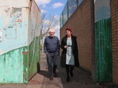 Shadow secretary of state for Northern Ireland Louise Haigh, right, alongside community worker Jackie Redpath during a visit to a community interface on Lanark Way between the loyalist Shankill Road and nationalist Springfield Road in Belfast (Brian Lawless/PA)