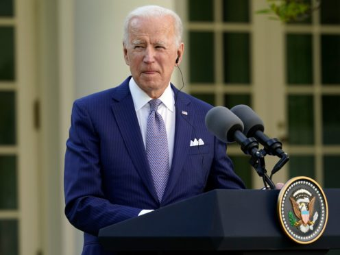 The White House has announced Joe Biden plans to lift his predecessor Donald Trump's historically low cap on refugees by next month (Andrew Harnik/AP)