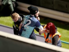 A Wycombe fan is led away by stewards after entering the Liberty Stadium to watch his side play Swansea (Bradley Collyer/PA)
