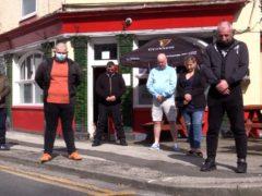 Drinkers at the Duke of Edinburgh pub in Hull observe a minute's silence (Richard McCarthy/PA)