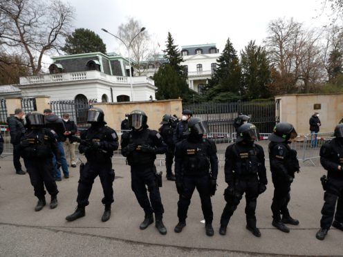 Riot police guard the area as protesters gather in front of the Russian Embassy in Prague (Petr David Josek/AP)