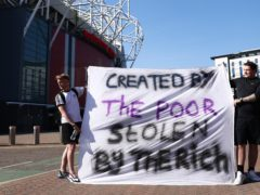 Football fans opposing the European Super League outside Old Trafford in Manchester (Tim Markland/PA)