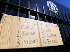 Protest sign outside Old Trafford (Tim Markland/PA)
