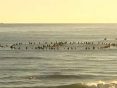 Surfers form a cancel symbol in the water off Byron Bay (Australian Broadcasting Corporation via AP)