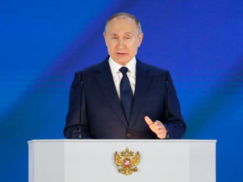 Russian President Vladimir Putin gives his annual state of the nation address in Manezh, Moscow, Russia, Wednesday, April 21, 2021. Putin's state-of-the-nation speech comes amid a new surge in tensions with the West over a Russian troop buildup near the border with Ukraine and a hunger strike by jailed Russian opposition leader Alexei Navalny protesting a lack of adequate medical treatment in prison. (AP Photo/Alexander Zemlianichenko, Pool)