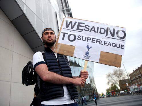 Tottenham fans stage a protest against the European Super League (Adam Davy/PA)