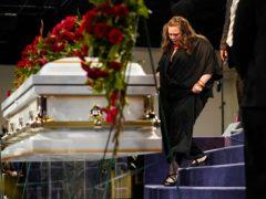 Katie Wright, mother of Daunte Wright, walks past his casket (John Minchillo/ Pool/AP)