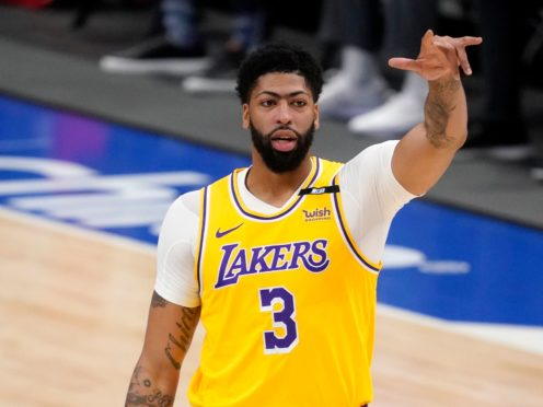The Dallas Maverick began a two-game series with a 115-110 win over the Los Angeles Lakers, whose eight-time all-star Anthony Davis was rusty on his return from injury (Tony Gutierrez/AP)
