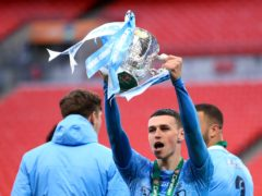 Manchester City's Phil Foden celebrates with the trophy after collecting a fourth Carabao Cup winners' medal (Adam Davy/PA)