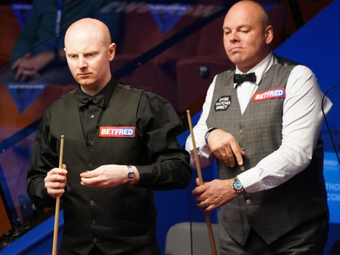 Anthony McGill, left, is ahead of Stuart Bingham going into the final session of their quarter-final in Sheffield (Zac Goodwin/PA)