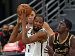 The Brooklyn Nets guaranteed their appearance in the post-season after they rallied late in the game to defeat the Toronto Raptors 116-103 (Chris O'Meara/AP)