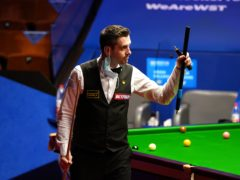 Mark Selby gestures after winning his match against Mark Williams during day 12 of the Betfred World Snooker Championships (Zac Goodwin/PA)