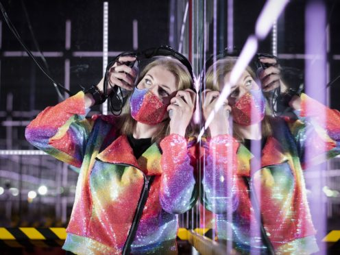 Gallery assistant Naomi Robb in one of the light and music installations (Jane Barlow/PA)