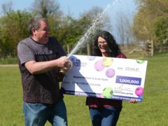 Stephen Webster and partner Arran Taylor celebrate his £1 million Lotto win (The National Lottery/PA)