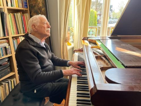 Alan Melinek has gone viral on TikTok playing the piano and raising money for charity (Cancer Research UK/pianograndad.com)