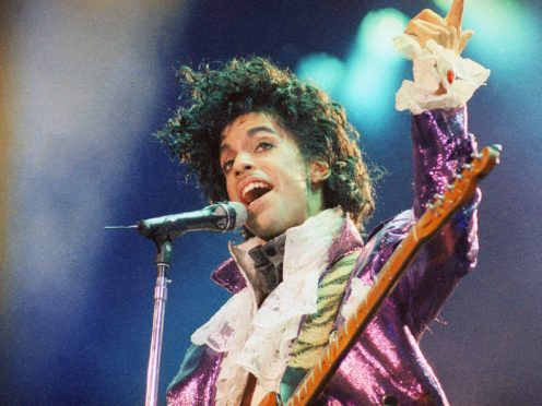 Fans of rock star Prince turned out to his former home in Minneapolis on the fifth anniversary of his death on Wednesday (Liu Heung Shing/AP)