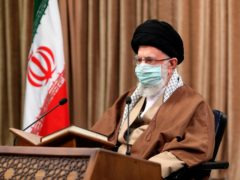 Supreme Leader Ayatollah Ali Khamenei wearing a protective face mask, attends a meeting in Tehran, Iran (Office of the Iranian Supreme Leader via AP)