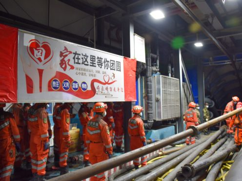 Rescue workers are trying to reach 21 coal miners trapped by an underground flood in north-west China (Gao Han/Xinhua News Agency/AP)