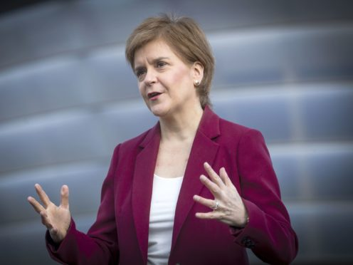 Nicola Sturgeon promised changes to the benefits system if the SNP are re-elected next month (Jane Barlow/PA)