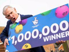 John McFadden from Southampton celebrates winning £1m on a National Lottery scratchcard (Handout/PA)