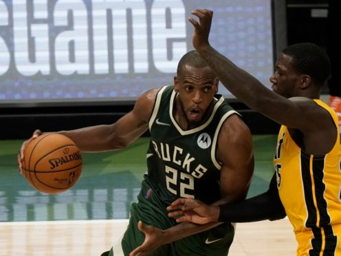 Khris Middleton snatched a dramatic late win for the Bucks (Morry Gash/AP)