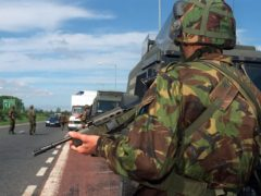 Soldiers man a checkpoint on the Belfast to Dublin road (PA/PA)