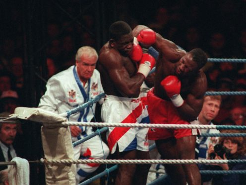 Lennox Lewis defeated Frank Bruno in Cardiff in October 1993 (David Jones/PA)