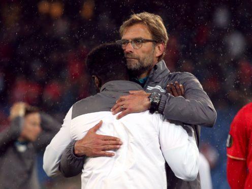 Jurgen Klopp consoles Kolo Toure after Liverpool's loss to Sevilla (David Davies/PA)