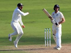 India's Virat Kohli, left, celebrates the wicket of England's Jos Buttler (Mike Egerton/PA)
