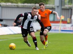Dundee United's Jamie Robson (right) was sent off in the goalless draw with St Mirren (Jeff Holmes/PA Images).